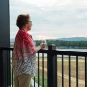 Senior looking over balcony